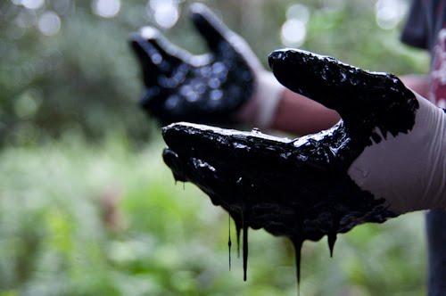 Chevron oil hands