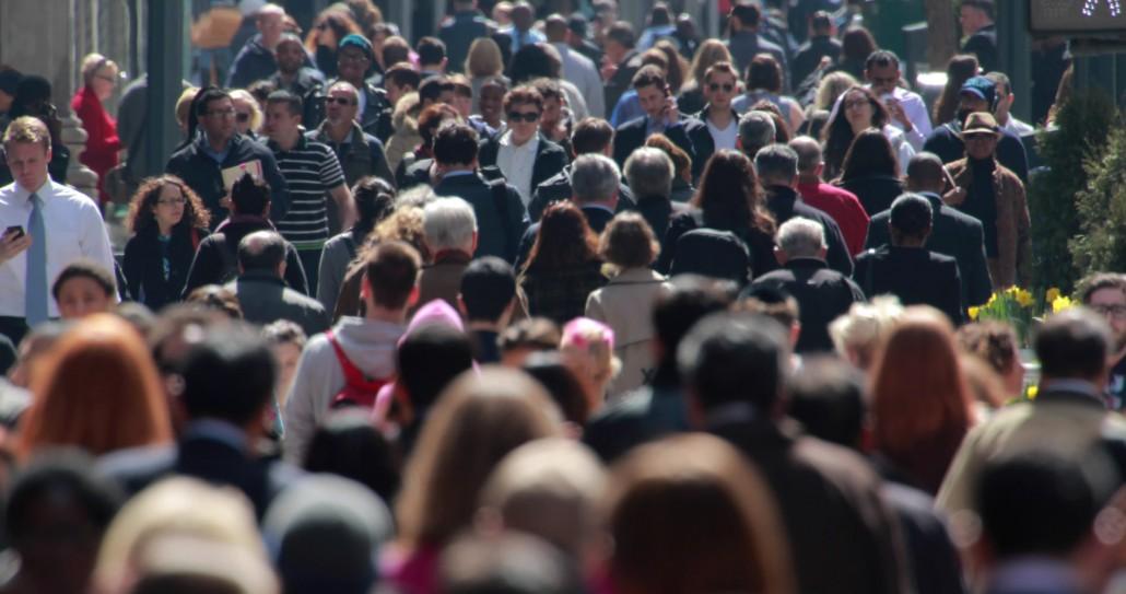 stock-footage-new-york-city-april-crowd-of-people-walking-on-street-sidewalk-k-e1418682210242