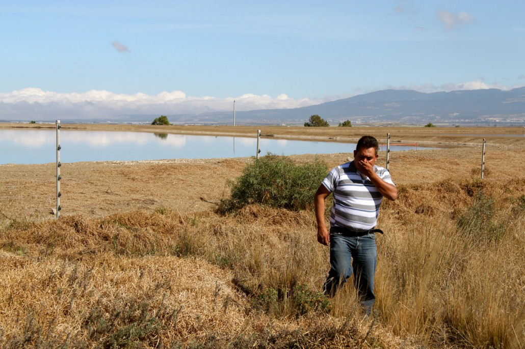 If photos could smell. Local resident covers him mouth in disgust at smell of GCM lagoon Perote