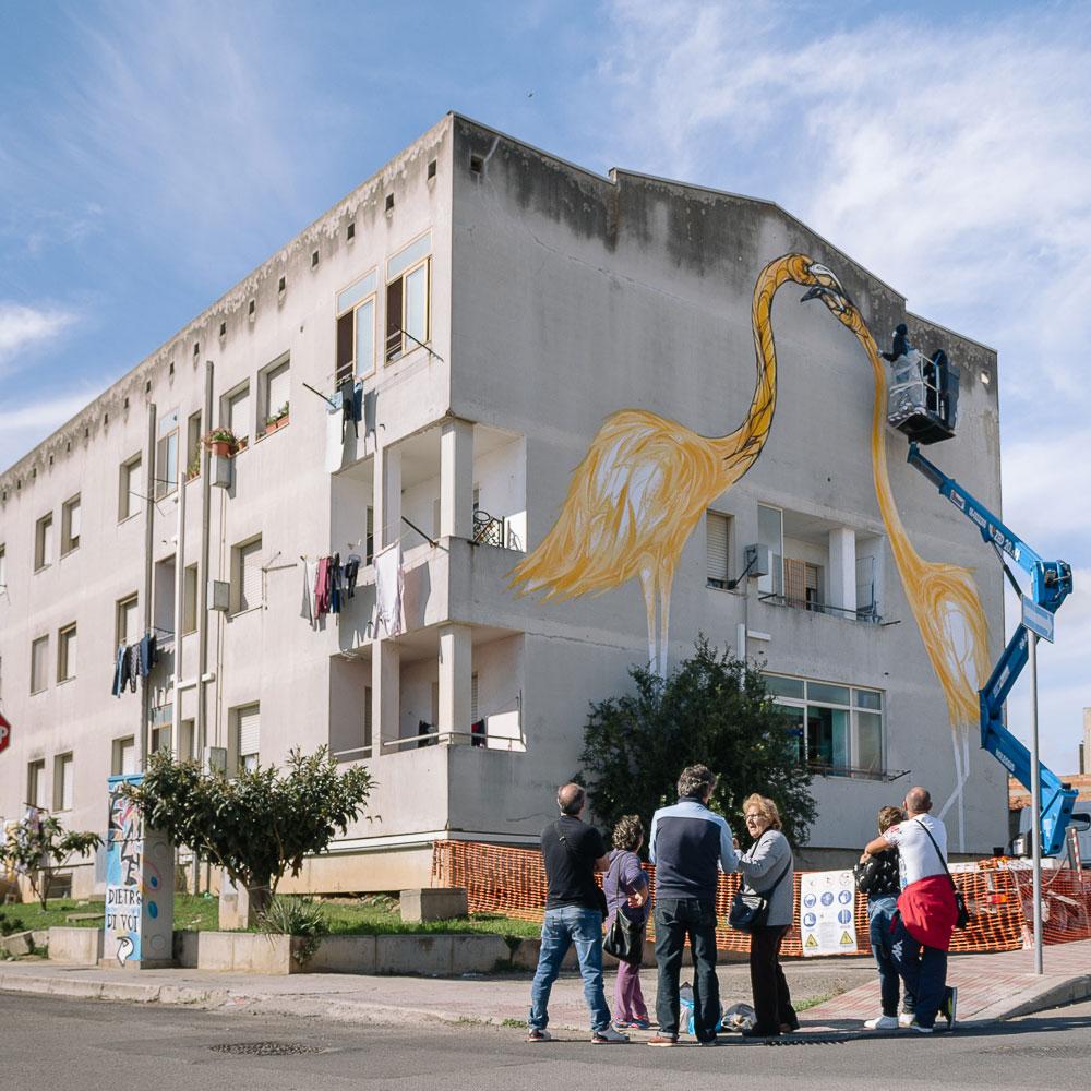 Is Murusu è un progetto di rigenerazione urbana di un quartiere di edilizia popolare attraverso la leva artistica che ha coinvolto sette artisti e si è svolto in tre mesi di lavori