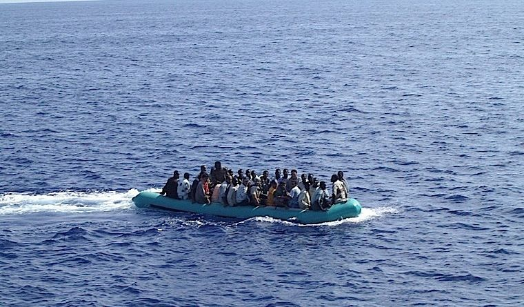 A-boat-with-immigrants-in-the-Mediterranean-Sea-on-their-way-to-Italy.-Source-currierimmigrationzone.it-760-x-445