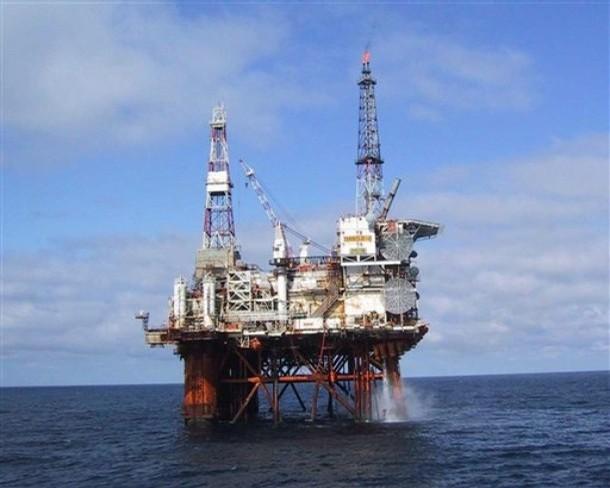 Blazing oil rig evacuated